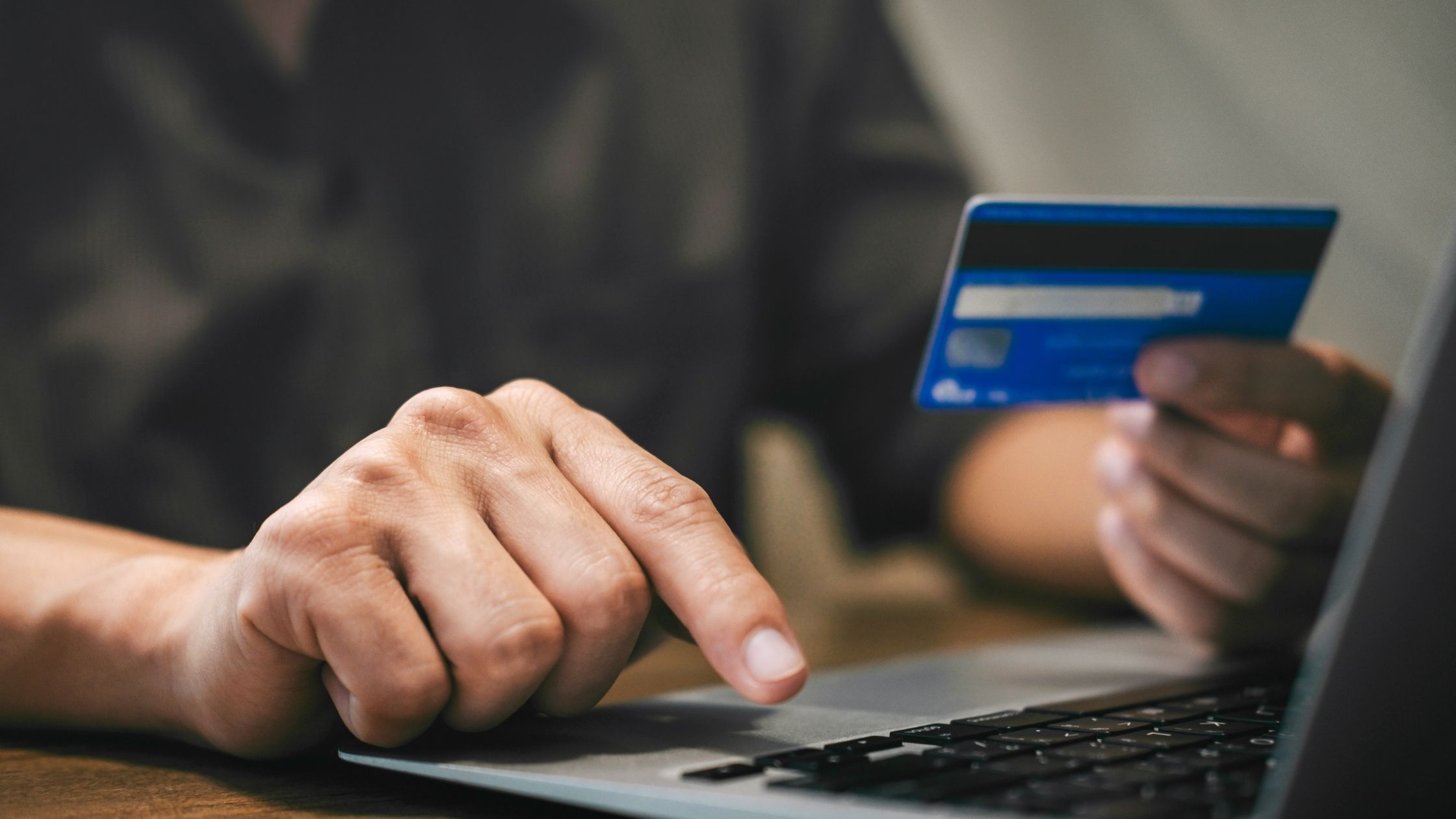 Person using Credit Card at Laptop
